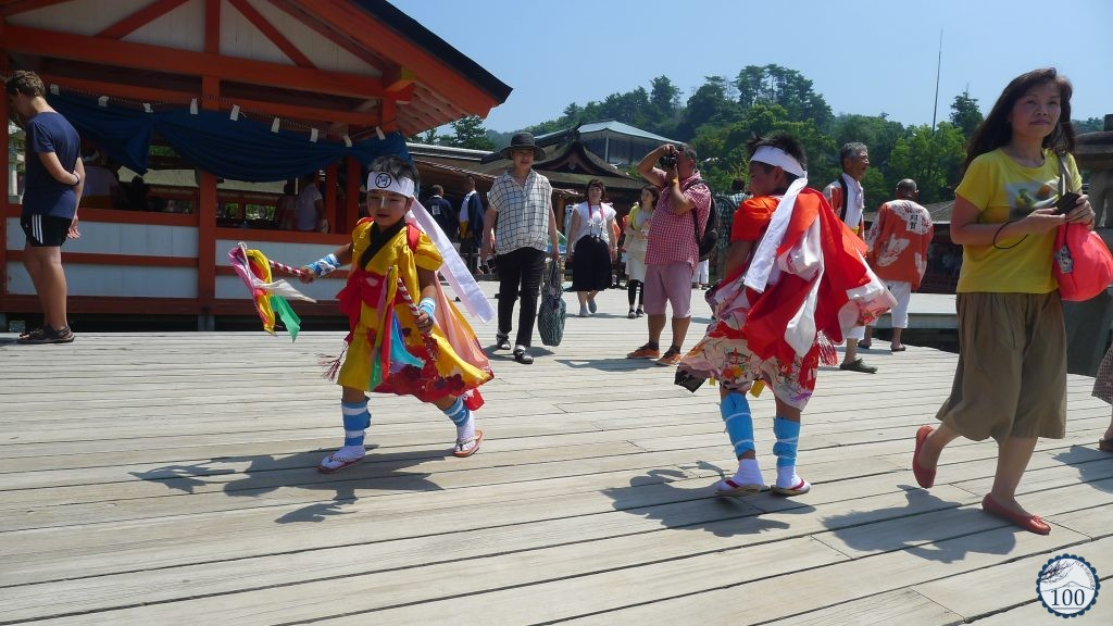 Playing time after a shinto ceremony in Itsukushima shrine.