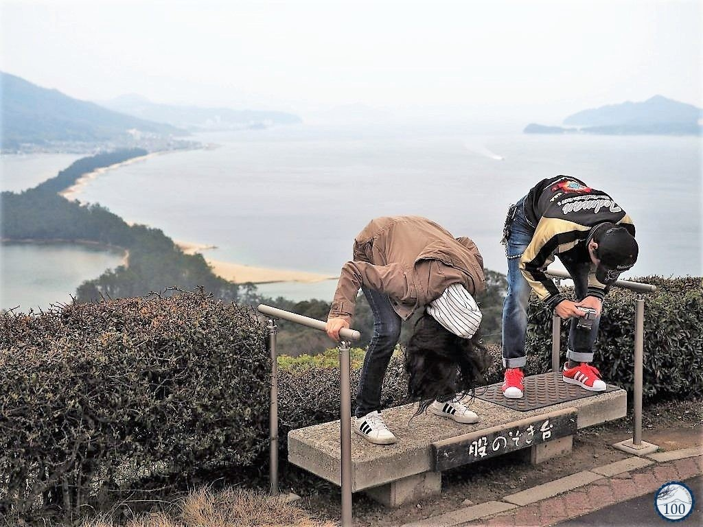 "Practicing the Matanozoki, the ""true"" way to observe Amanohashidate sandbar."